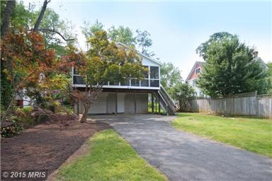 Large rear yard with driveway