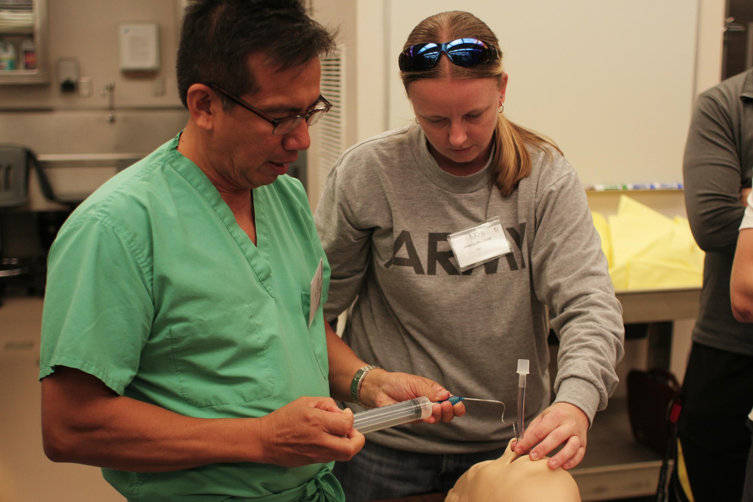 Dr. Martin Eason demonstrates proper airway management.