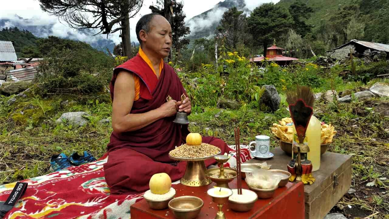 - The head monk representing the Abbott at the Tengboche monastery presides over the dedication ceremony.