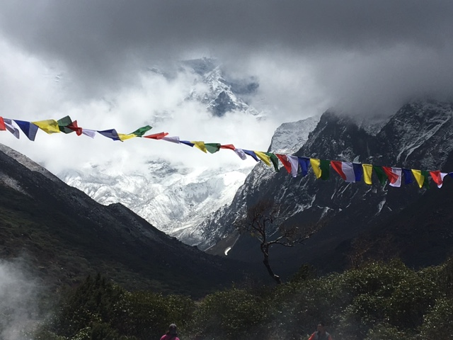 - Prayer flags flying in the stormy Himalaya.