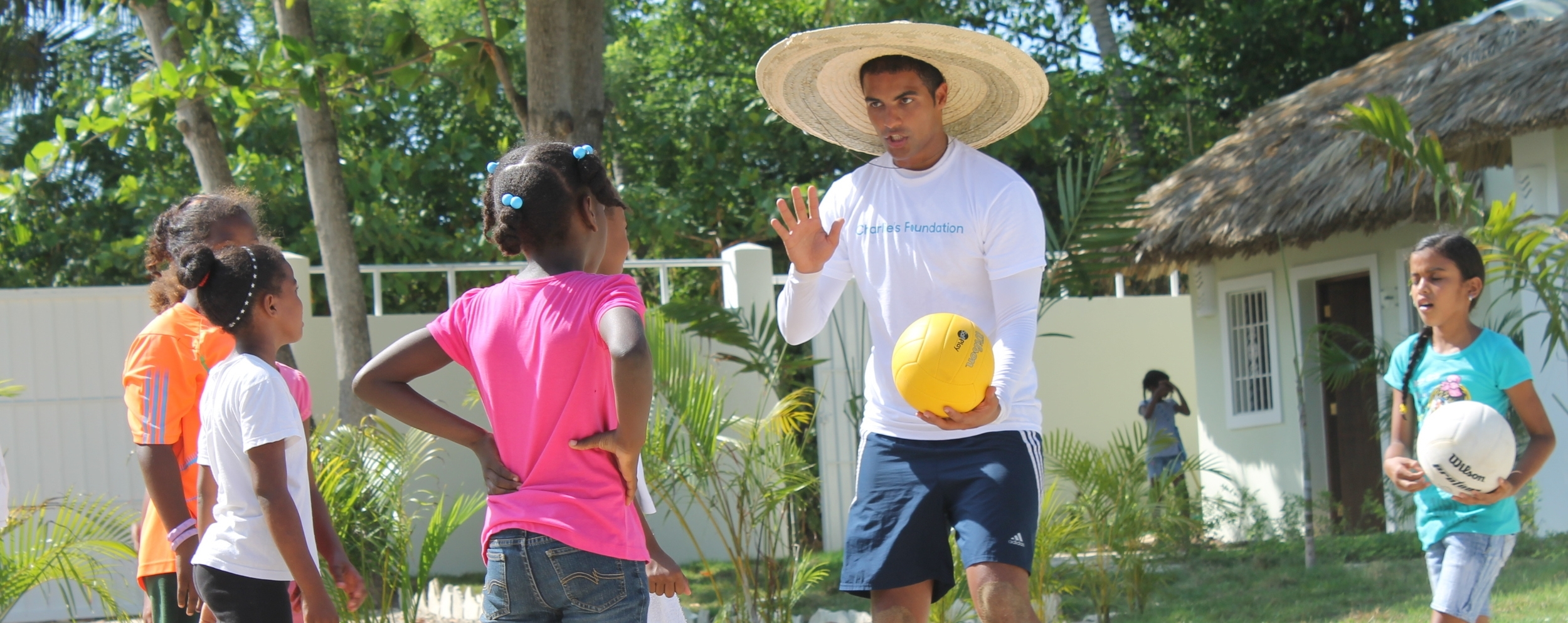 Sergio, one of our volunteers, teaching the girls volleyball on Saturday