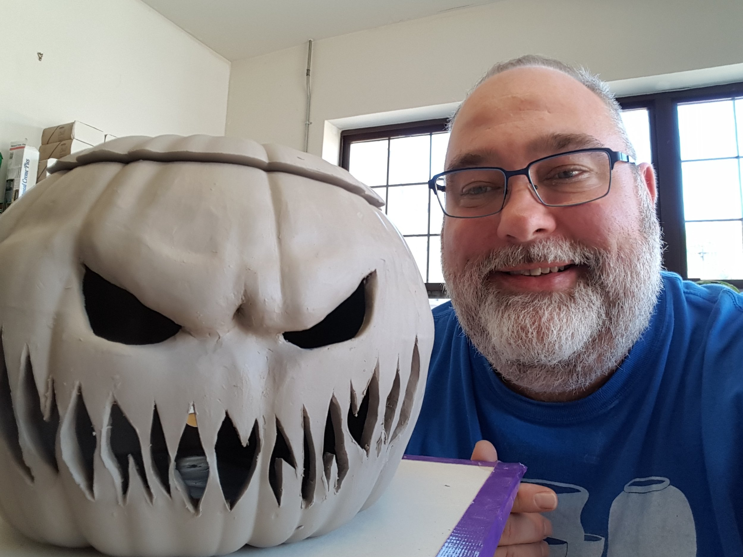 This is a plain pumpkin plaster mold. Liquid clay is poured into the mold to form the pumpkin. Once removed, the brow was formed by pushing out the clay from inside and then cutting out a face