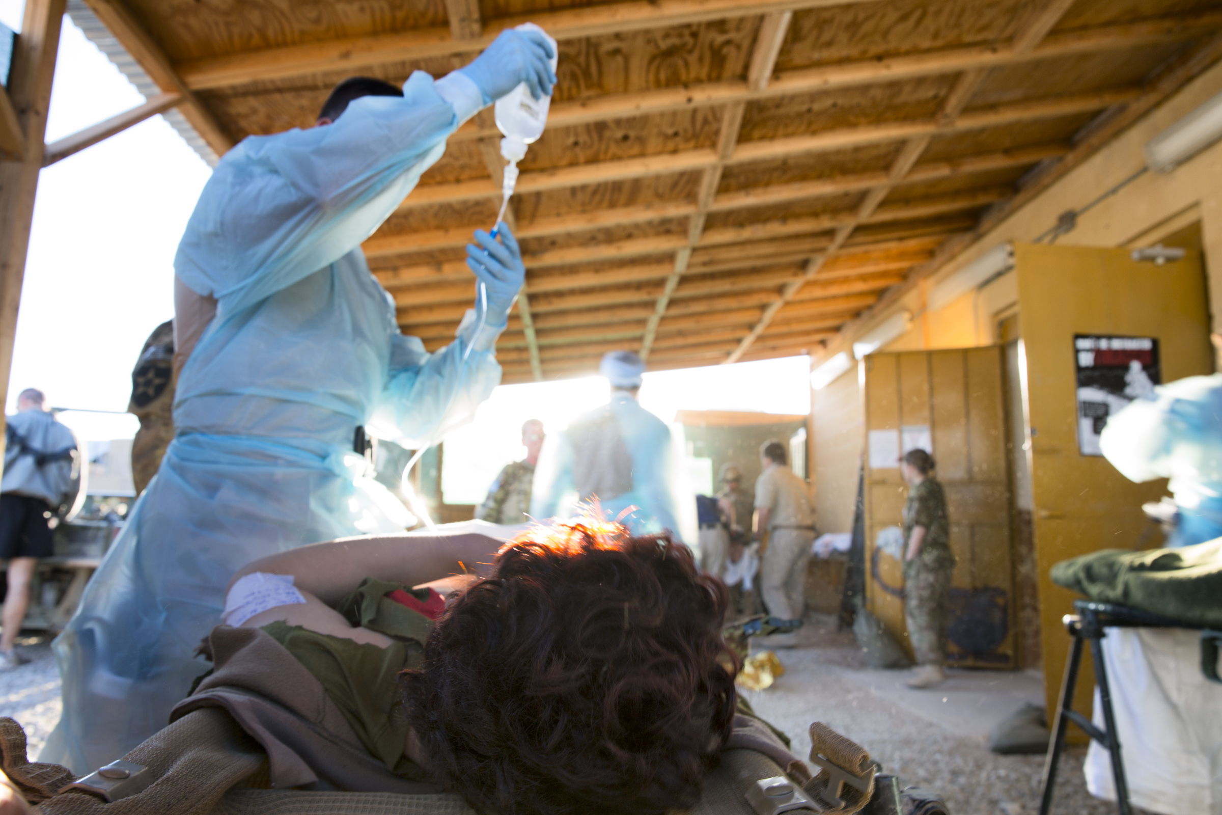 A medic attends to a wounded Afghan soldier at the Forward Operating Base Farah aid station (Farah, Afghanistan).