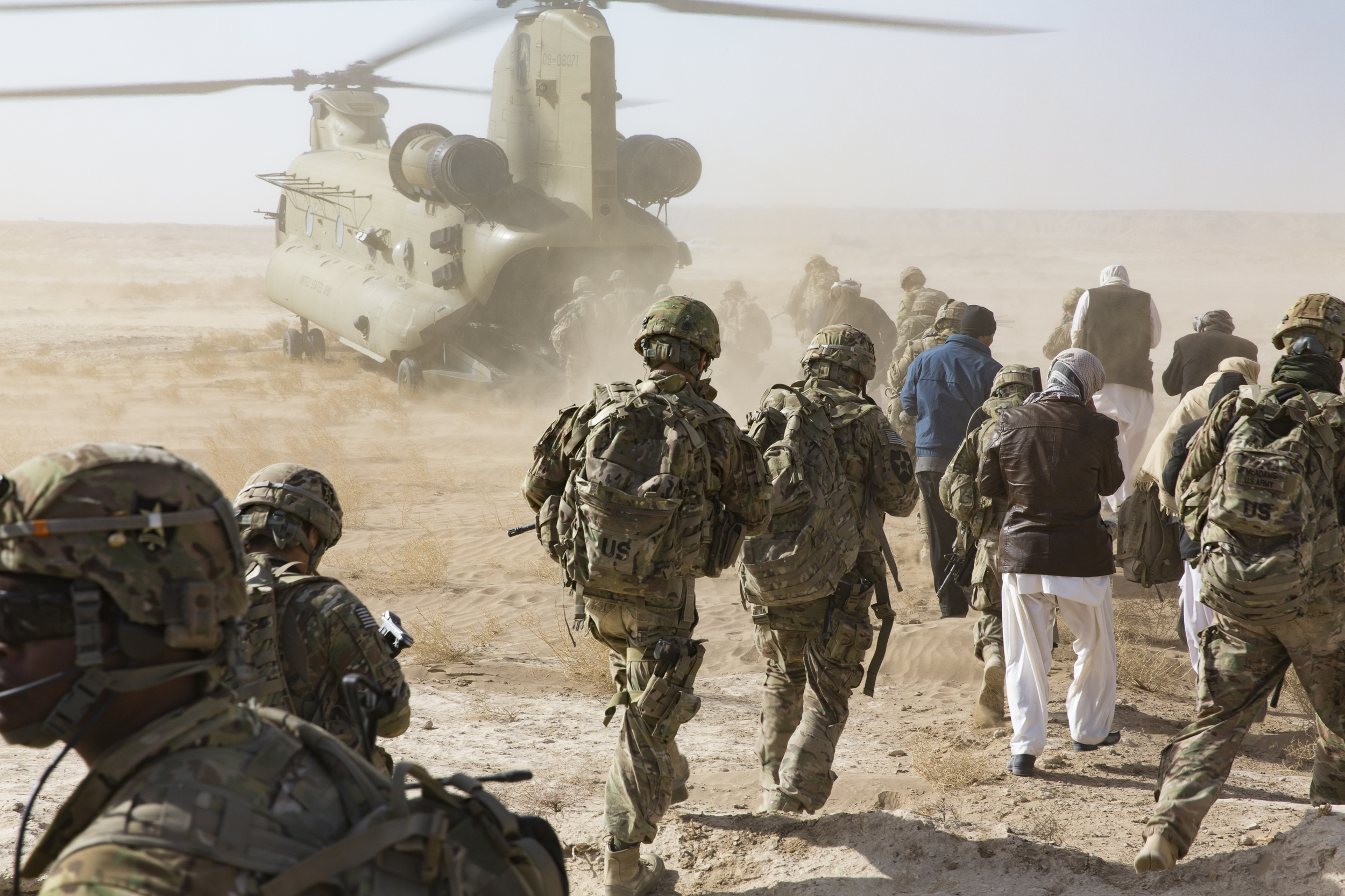 US Army Soldiers and Farahi leaders board a chinook helicopter in Lash-e Juwayn to return to Forward Operating Base Farah, Afghanistan