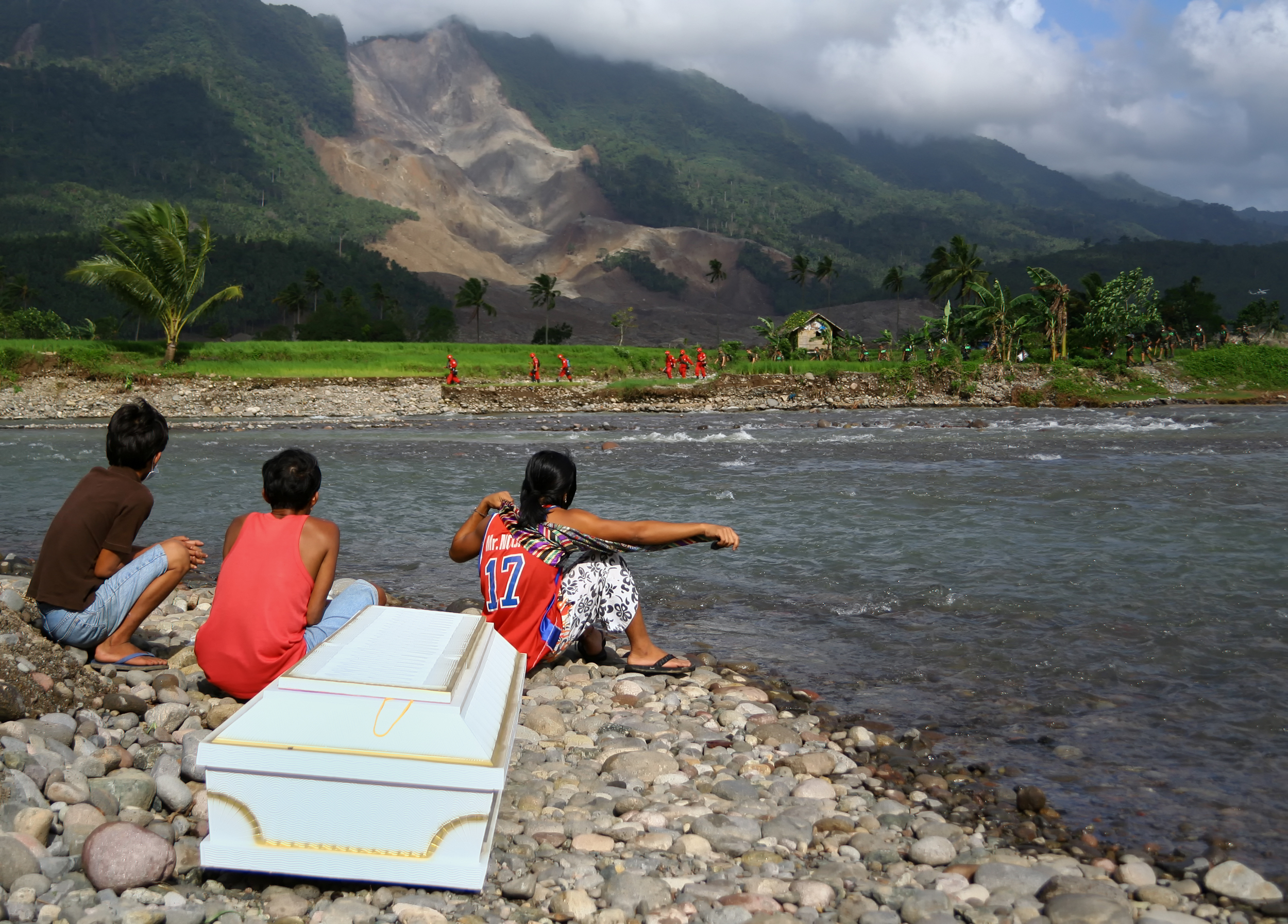 Awaiting the arrival of a family member killed in a landslide on the island of Leyte, Philippines.