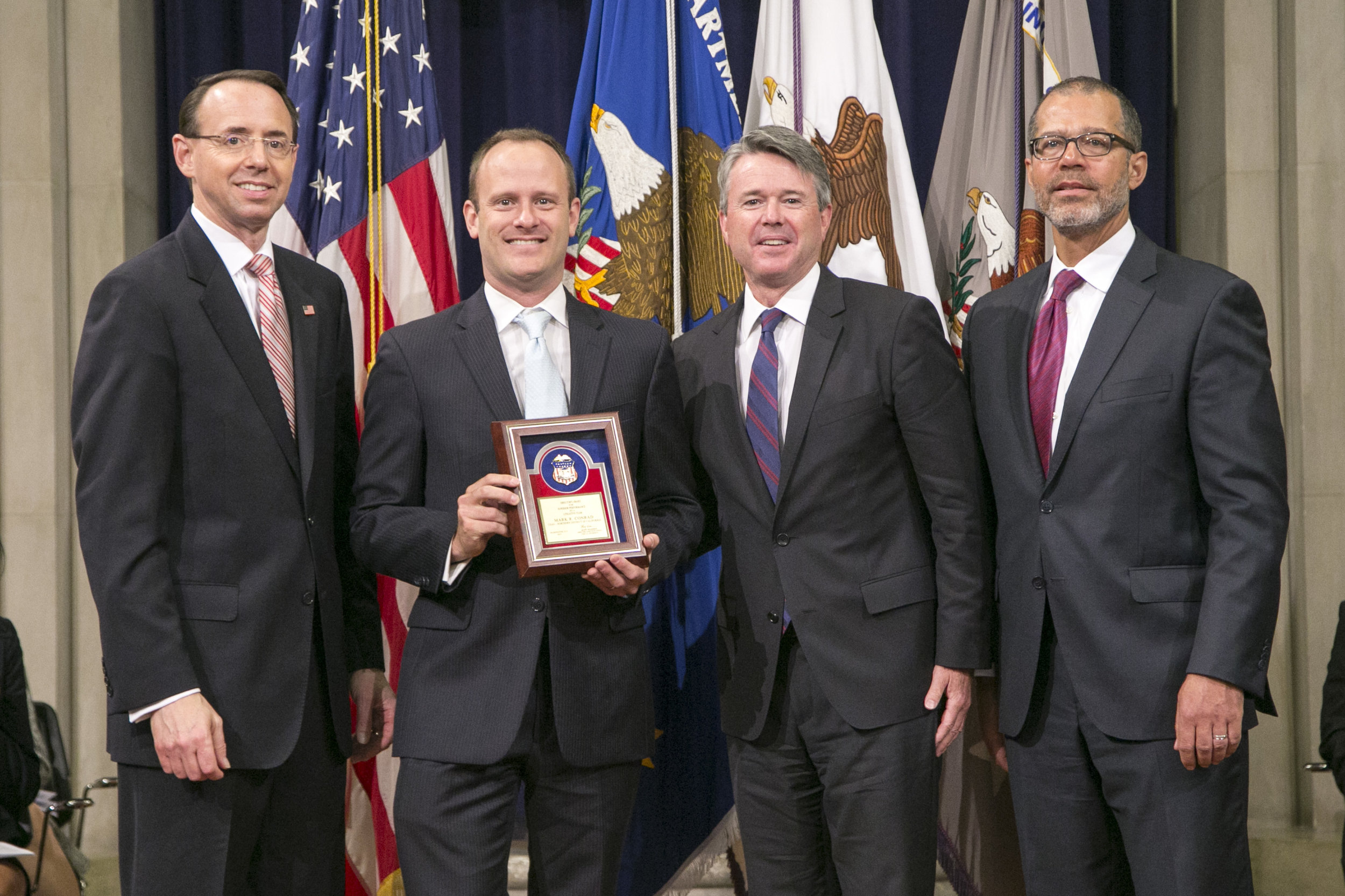 From left: Rod Rosenstein, Deputy Attorney General; Mark Conrad; Brian Stretch,  U.S. Attorney for the Northern District of California; Monty Wilkinson, Director of the Executive Office for United States Attorneys