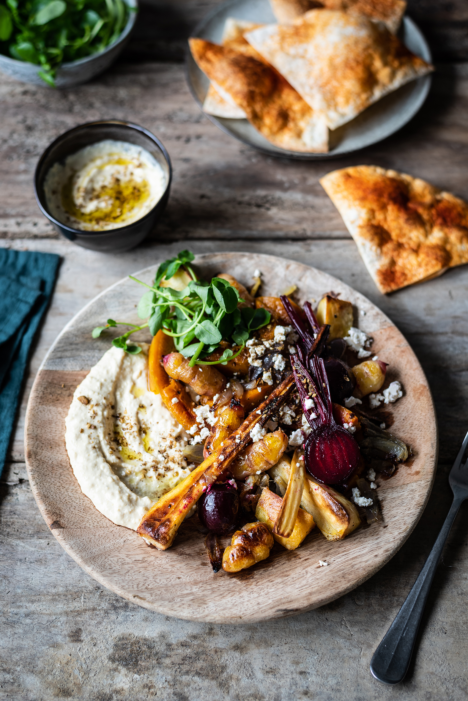 WINTER VEGETABLE SALAD - Golden and crunchy, roasted root vegetables topped with fragrant dukkah and feta cheese. Serve with a generous spoonful of Lisa's Smokey Hummus and baked tortilla crisps. Alternatively, use leftover roasted vegetables as a quick and easy lunch idea.