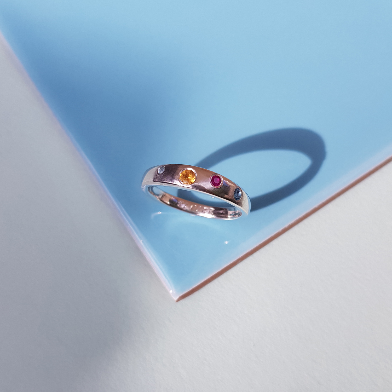 Silver-ring-set-with-aquamarine,-citrine,-ruby-and-topaz.jpg