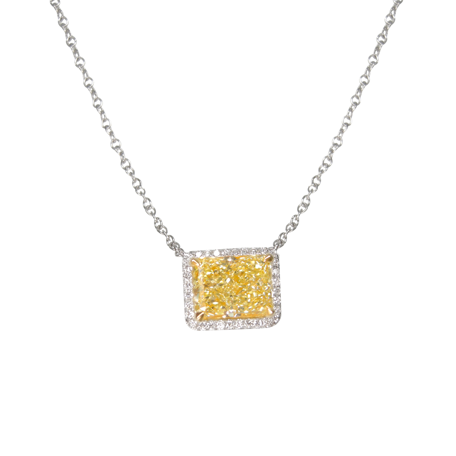 FANCY YELLOW DIAMOND RADIANT CUT WITH MICROPAVE HALO