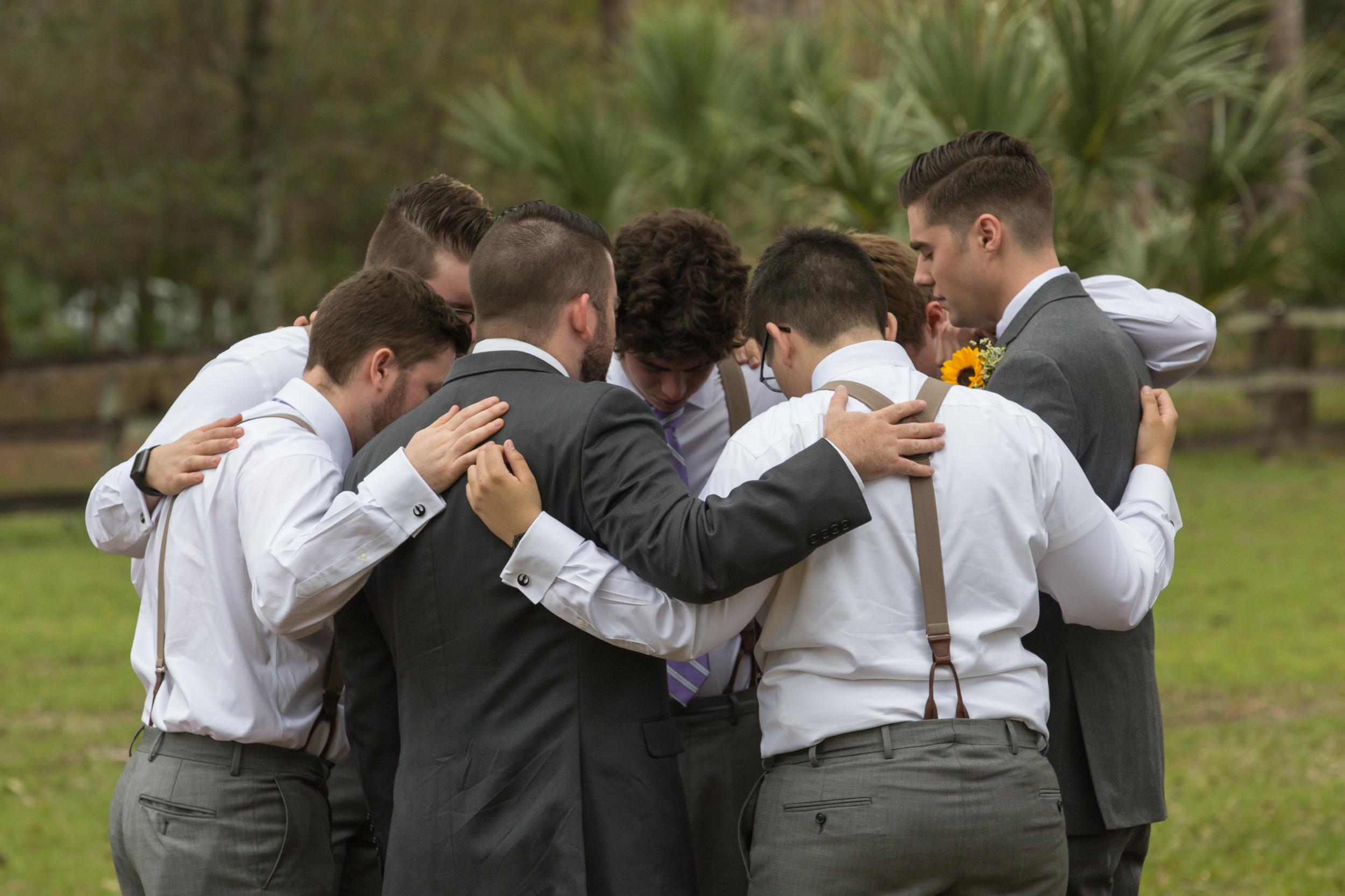 QN9A5106 Adjusted Mitchell & groomsmen prayer.jpg