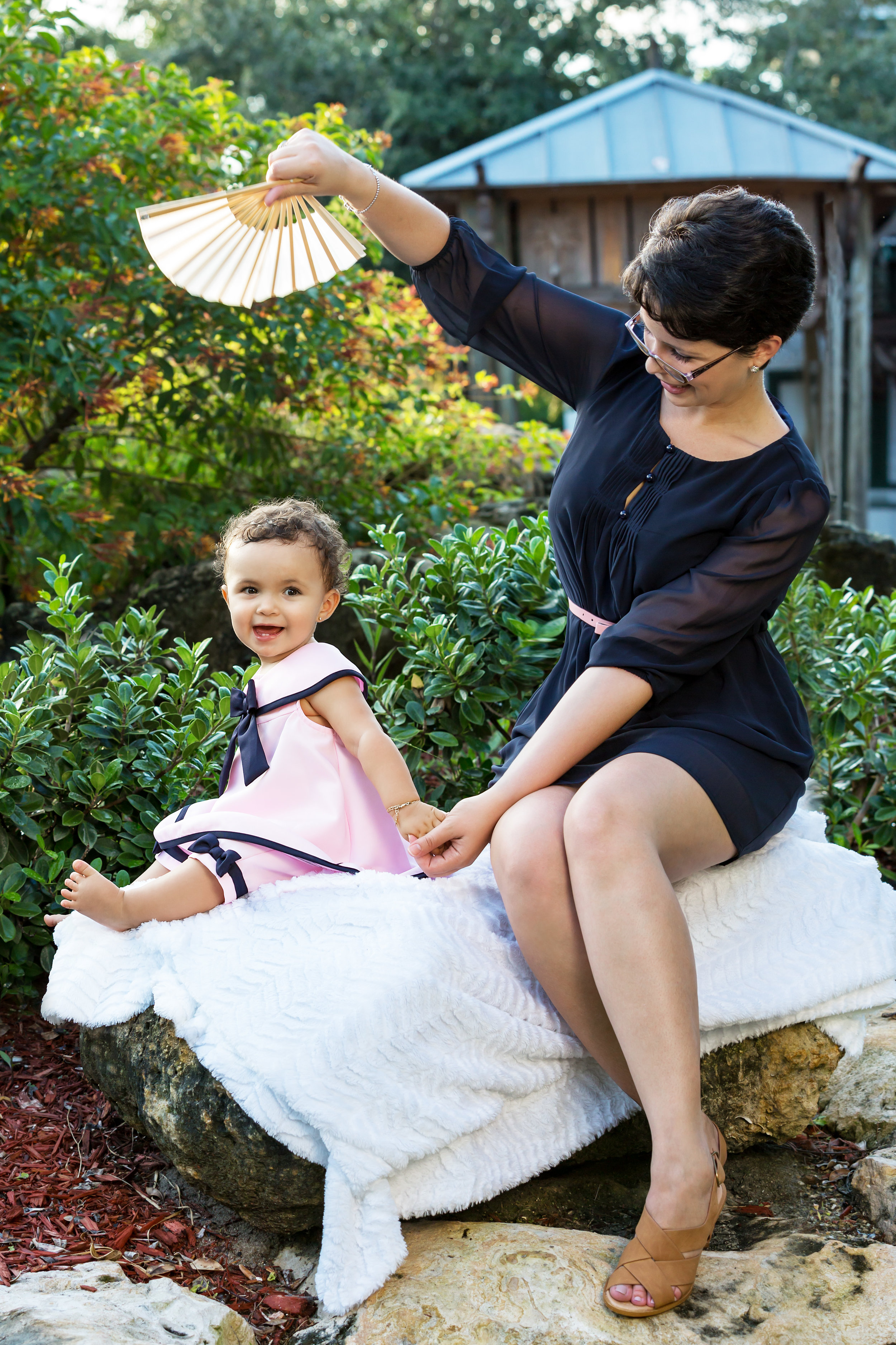 QN9A0705 Adjusted Mom Fanning Baby.jpg