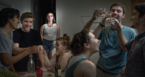 Molly Smith (back) participates in a party scene re-enactment to tell her story of recovery.