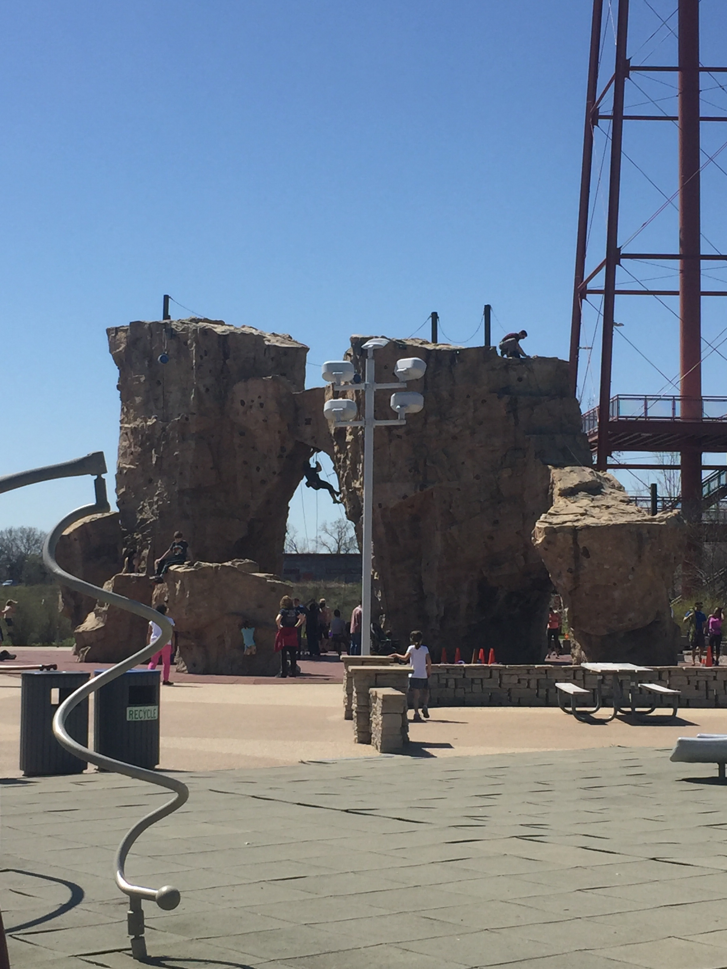 Watch some rock climbing while you play on the playground!