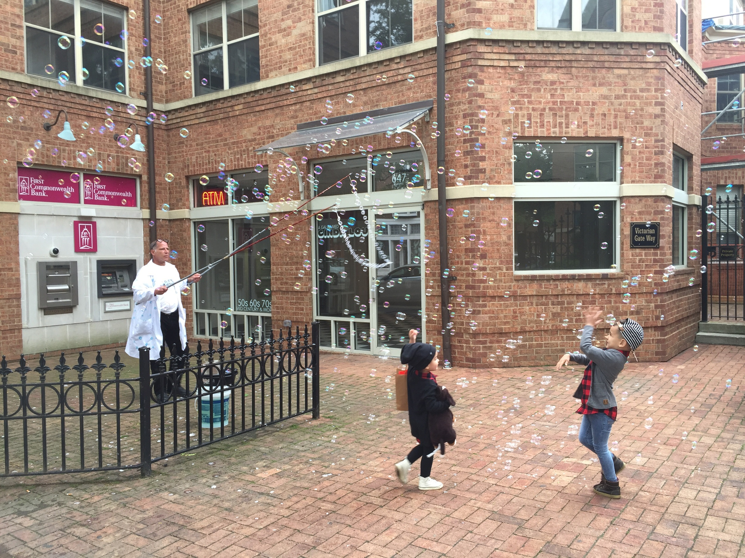Post shopping bubble fun with Dr. U R Awesome!!! He holds two Guiness World Records for his giant bubbles. Check him out  here