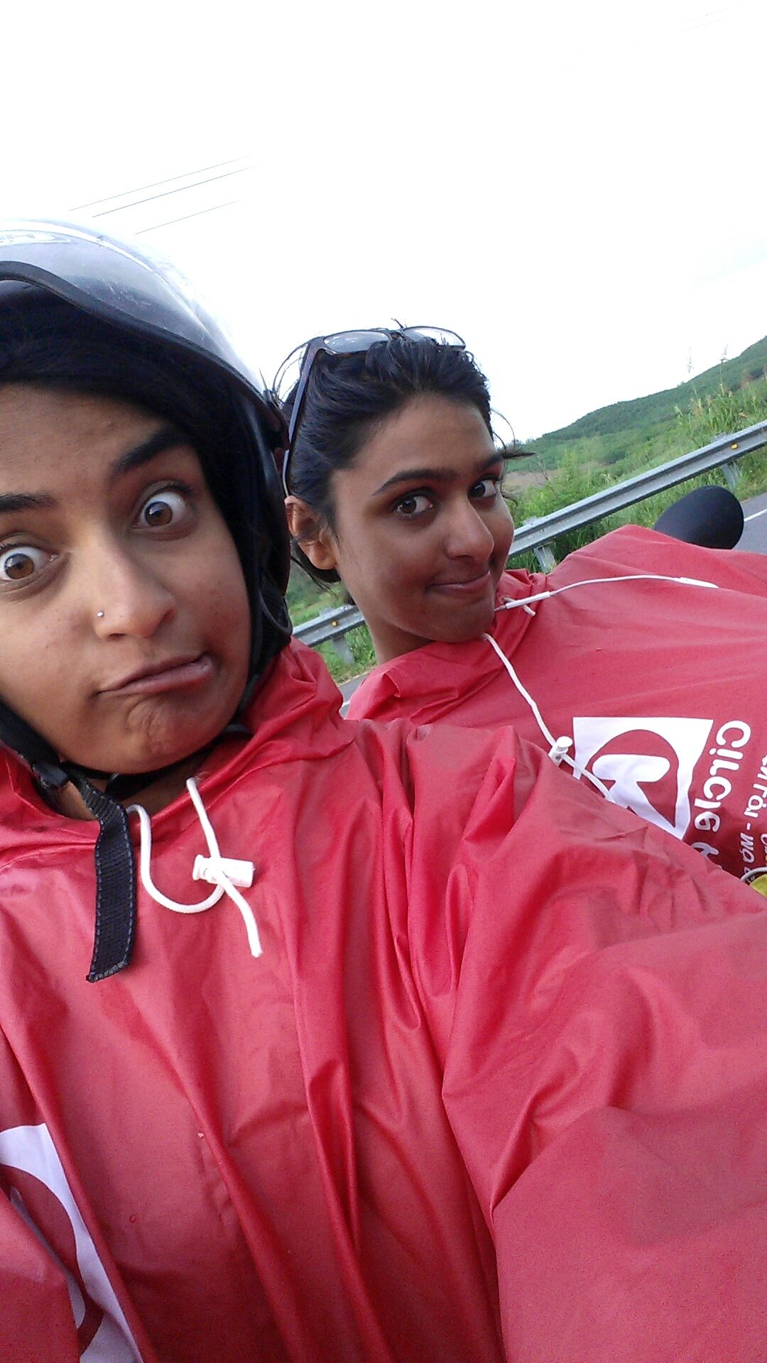 Us wearing our glorious ponchos