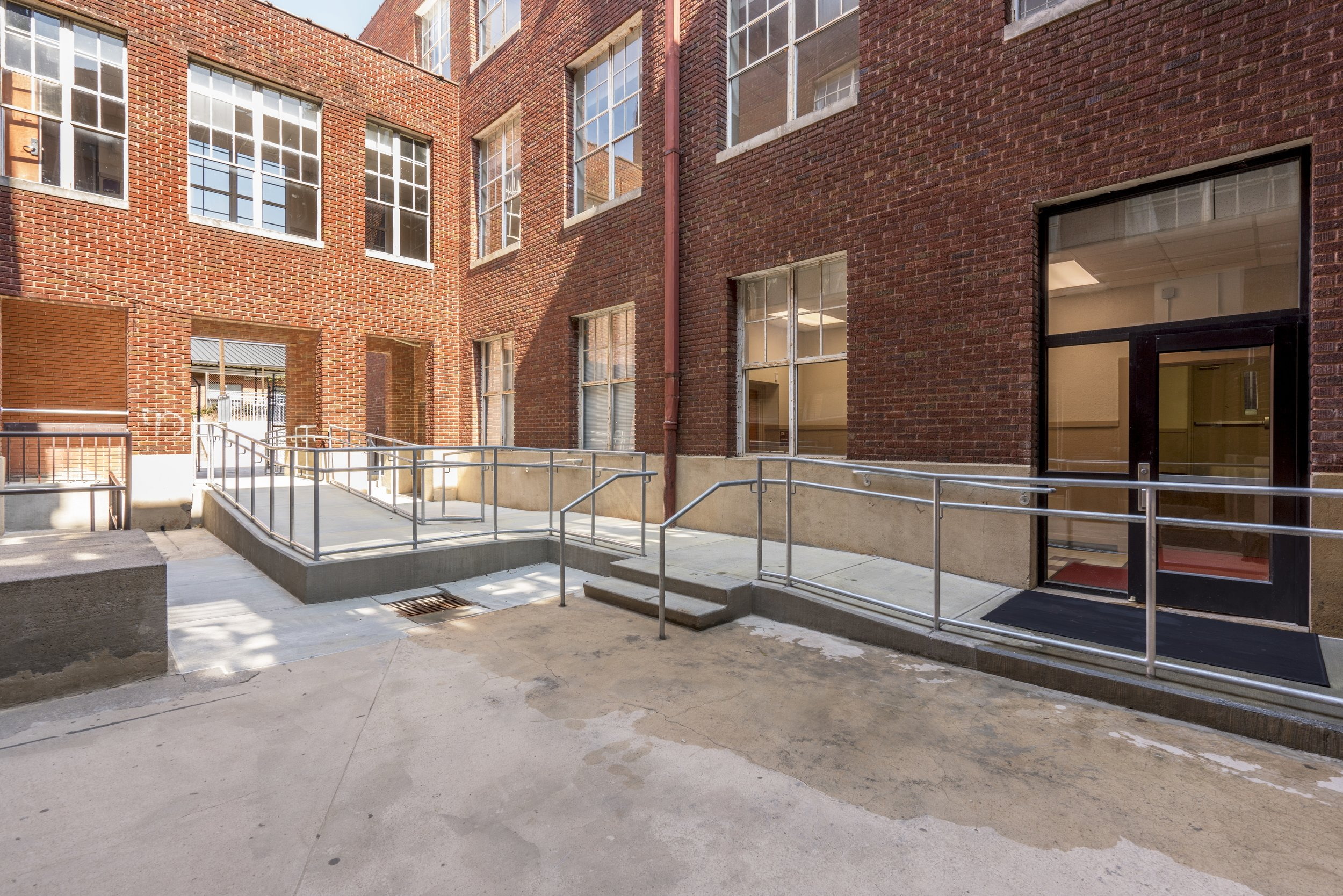 EXTERIOR HANDICAP ACCESSIBLE RAMPS added ramps in courtyard