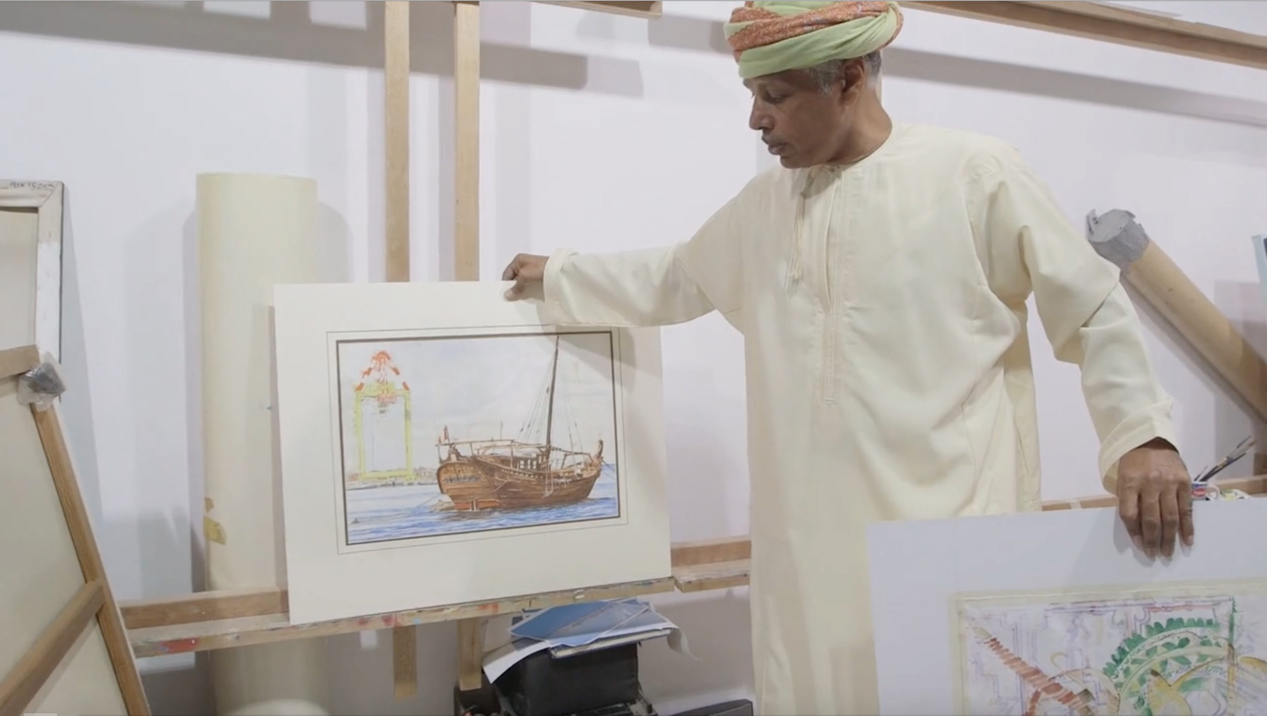 Omani visual artist Madny Al Bakry in  Arts of the Monsoon . Photo still courtesy of the Smithsonian's National Museum of African Art