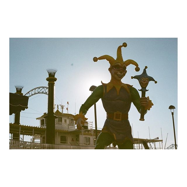 A jester looming over #nola . Shot on a vintage Yashica FX-3 super. #50mm #film