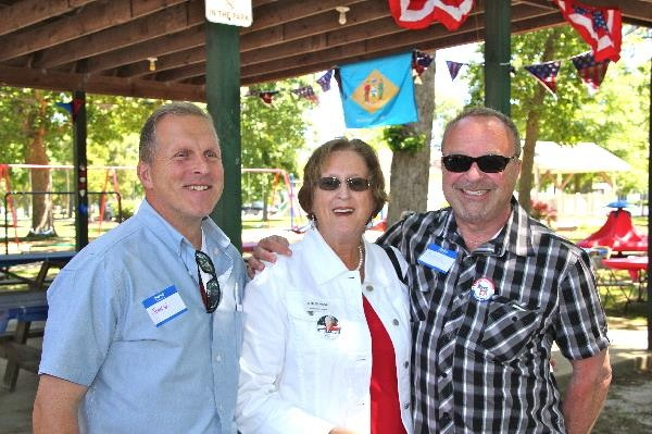 Sussex Democratic Party chairman Mitch Crane (right) with candidate Shirley Price and Democratic activist John Workman.