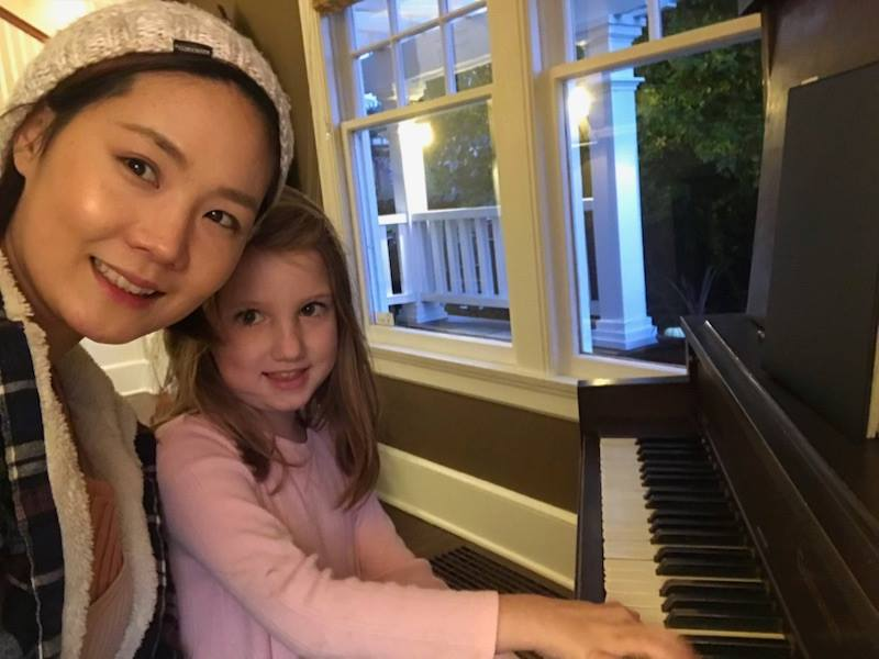 Our piano teacher April Kim & a young piano student