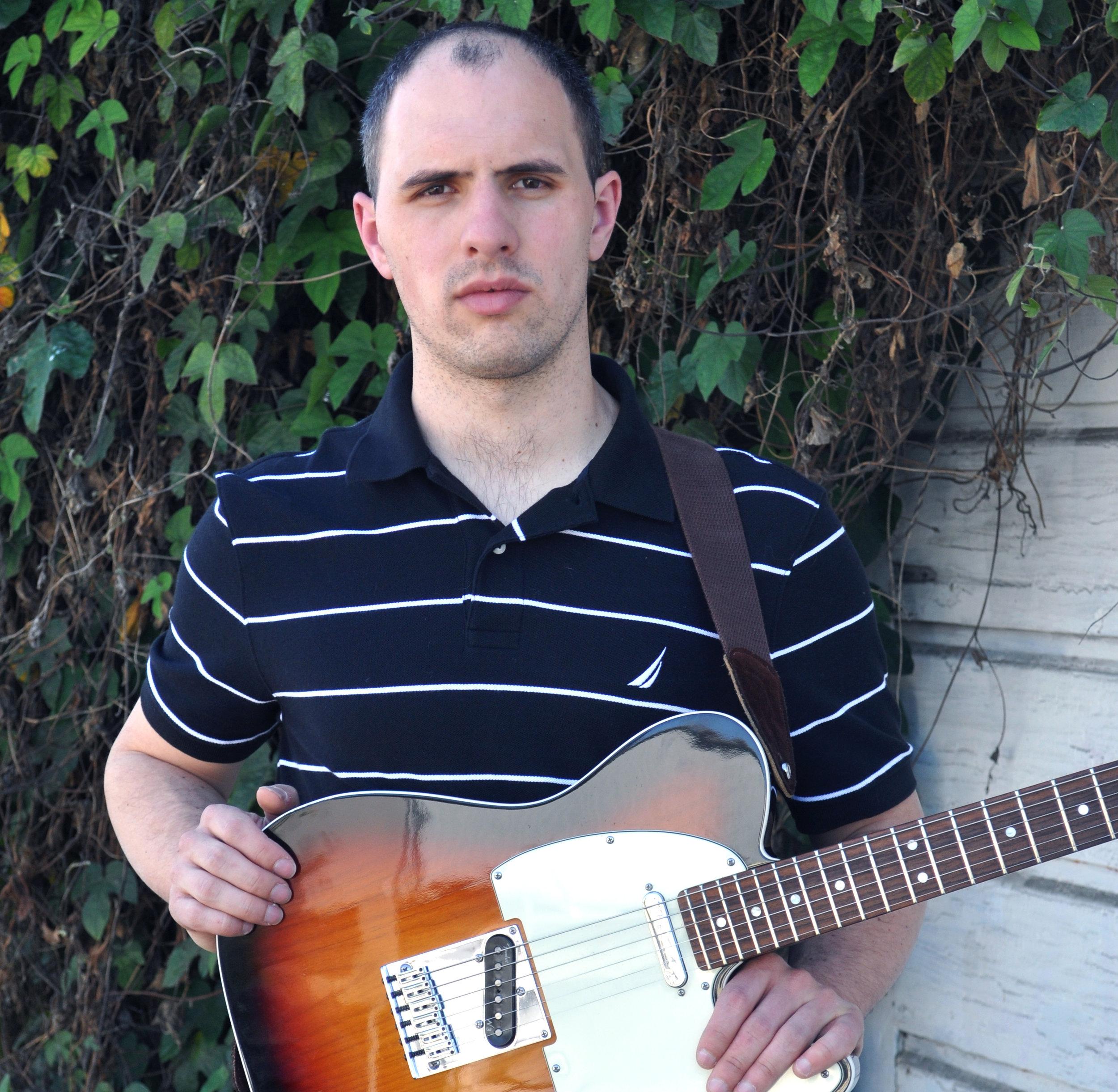 Bass, Guitar & Ukelele Teacher Christopher Main