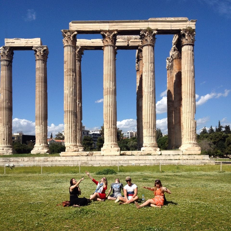 Taking a break in Greece enjoying the sun and the view at Temple of Olympian Zeus in Athens