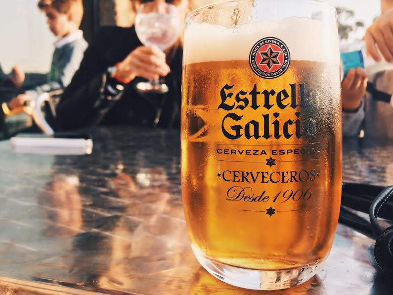5.15 /8:06 post meridiem // This beer, Estrella Galicia, is brewed in A Coruna and is not only popular but it is also the only beer I see anyone drink. It's delicious, too. On Sunday, the family with their 2 friends from Seville and I went to Santa Cristina Beach. There are restaurants, bars, and a boardwalk that wraps around two sides of the beach. It seems that everyone and their dog, literally everyone's dog, was out walking. We got there around 7:30 and stayed til 9:30. People of all ages, solo or in groups, were drinking, walking, and enjoying the sunny day. Drinking a beer or a light cocktail on a weekday or Sunday evening is common here. Walking around town or the beach is a pastime that I wish was more popular in the states. The beach was breathtakingly beautiful. I will be visiting with my camera soon.