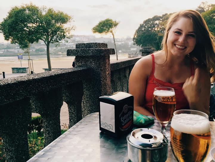 This is my happiest smile while drinking beer on the beach at my go-to bar. I swear I'm not flipping you off.