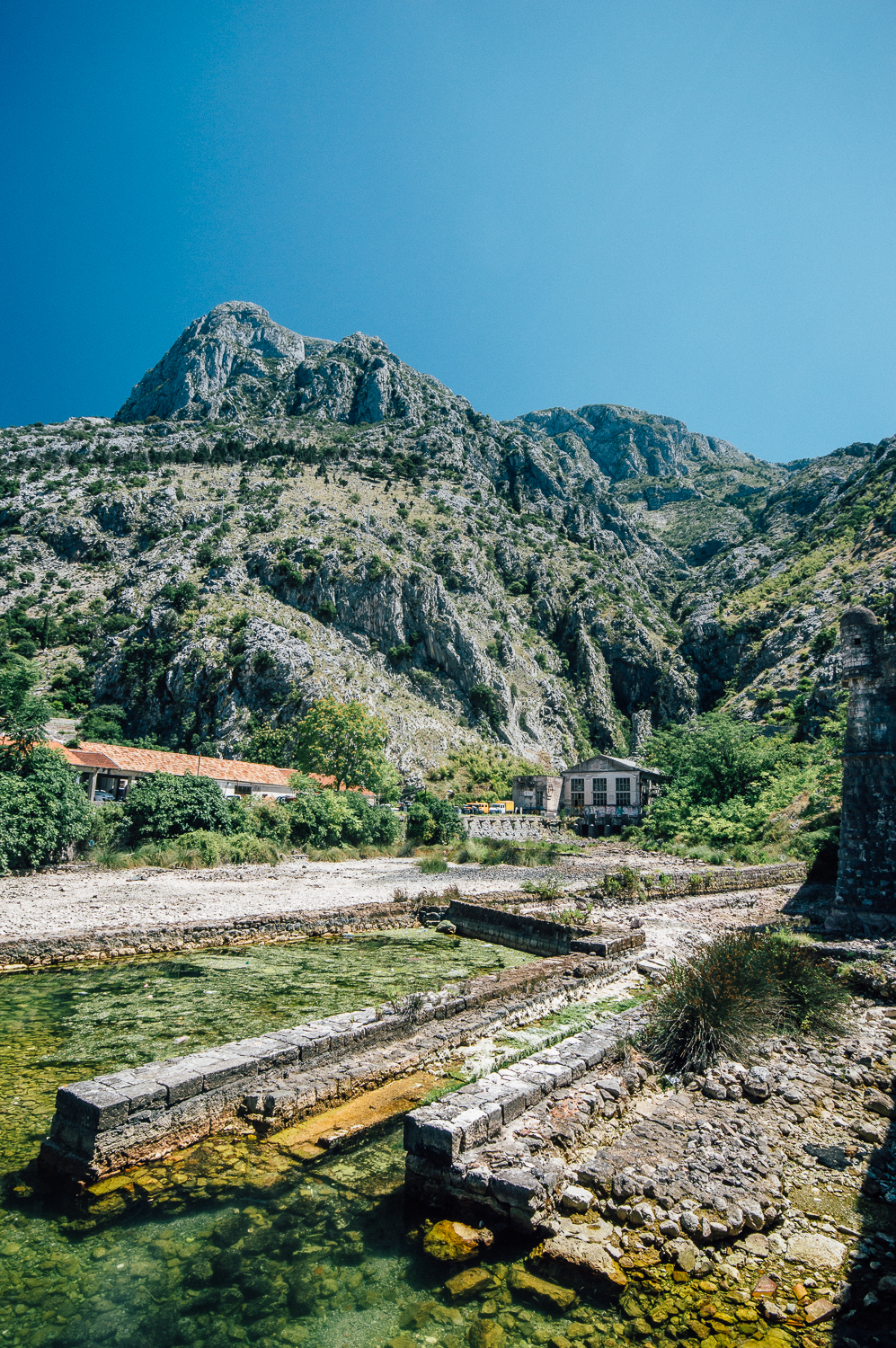 The exterior of the Old Town fortress walls  and magnificent mountains