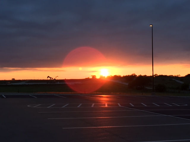 Last week, I spent a couple of long evenings at the Karnes detention center in Karnes City, Texas. The sun sets late out here, and as soon as I walked outside, I snapped this view of the gorgeous sunset—one that the detainees inside sadly wouldn't be able to see.