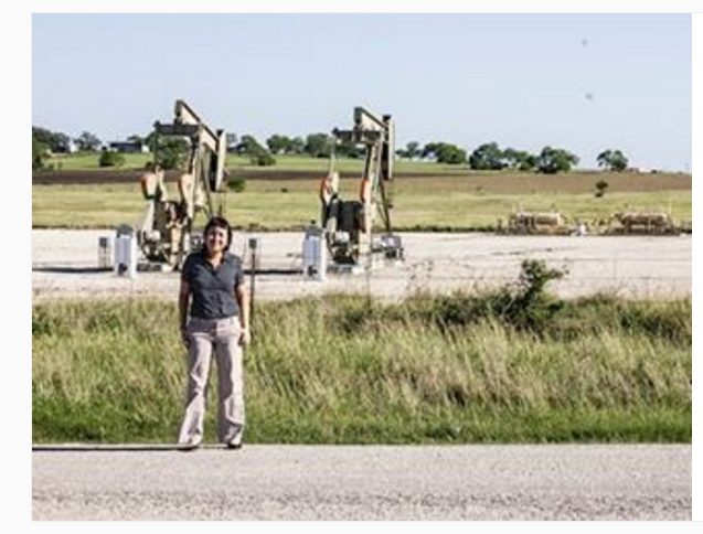 Stop #10: RAICES/Detention Center in Karnes City, Texas -- outside the detention center facility, there is nothing but oil rigs and flat Texas prairie.