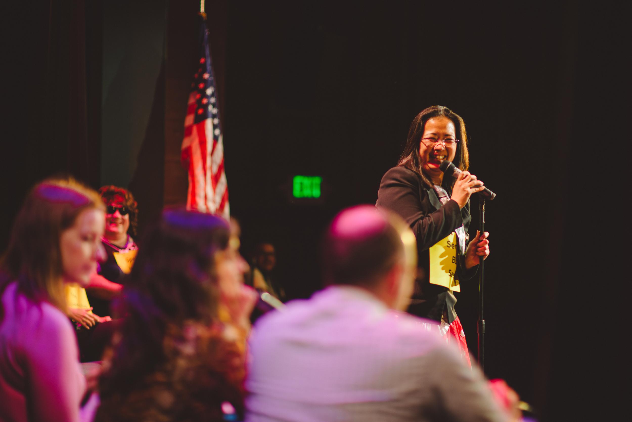 Speller at Adult Spelling Bee Fundraiser for School