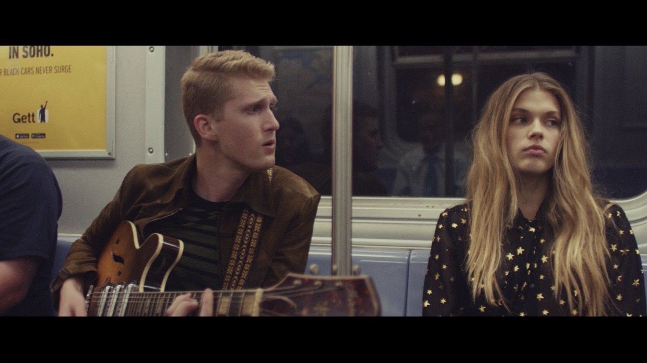 """Victoria Lee and I on the tram. Still from the """"Brooklyn"""" film. Directed by Warren Elgort."""