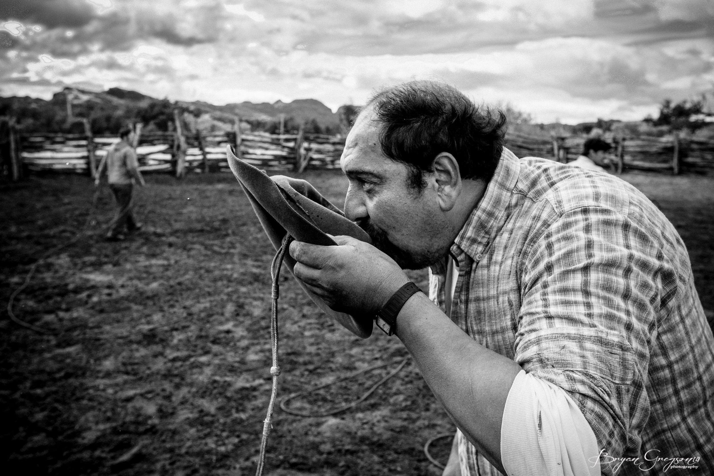 The Killer, a guacho, drinks beer from a hat. Photo:  Bryan Gregson Photography