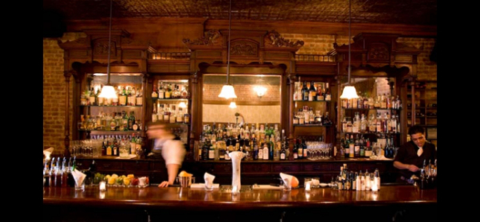 The Clover Club - Evoking another era with its ornate wood paneling and vintage fixtures.