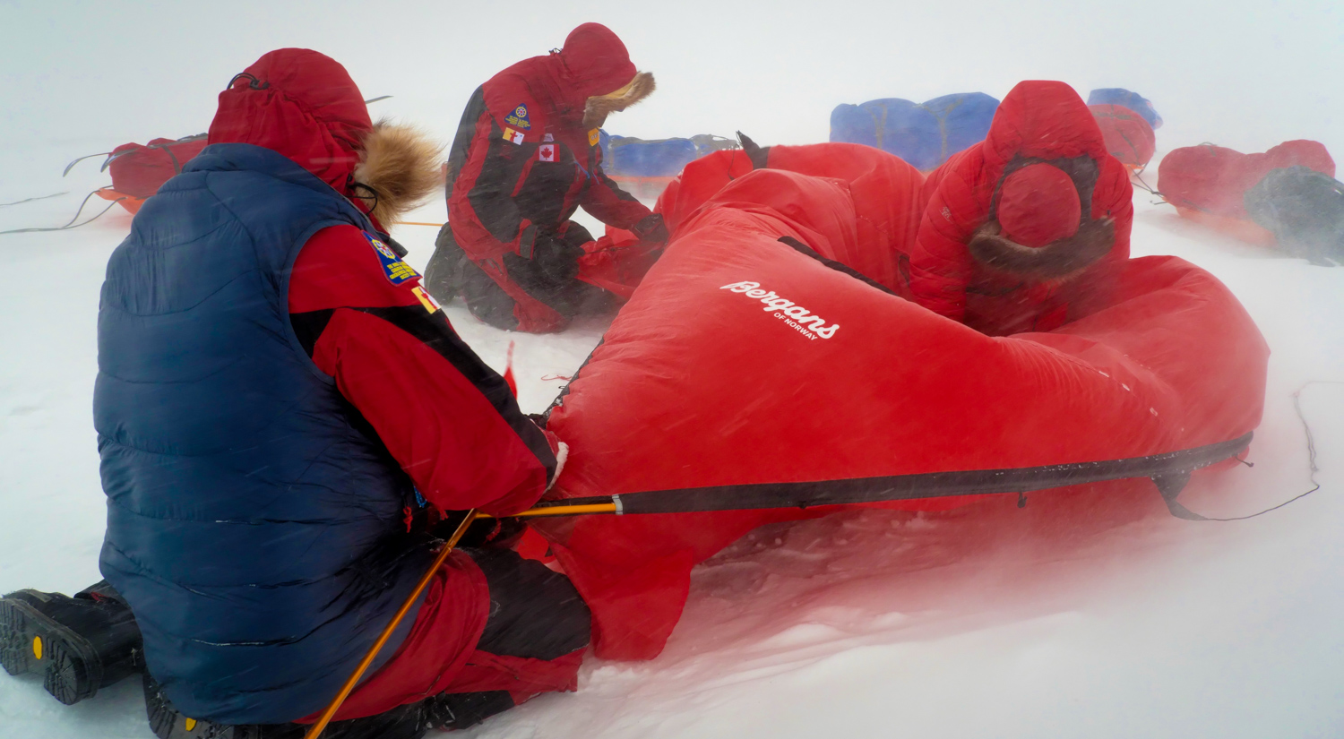 John and teammates put up their tent in a storm off the coast of Axel Heiberg Island, Canada. © Kyle O'Donoghue