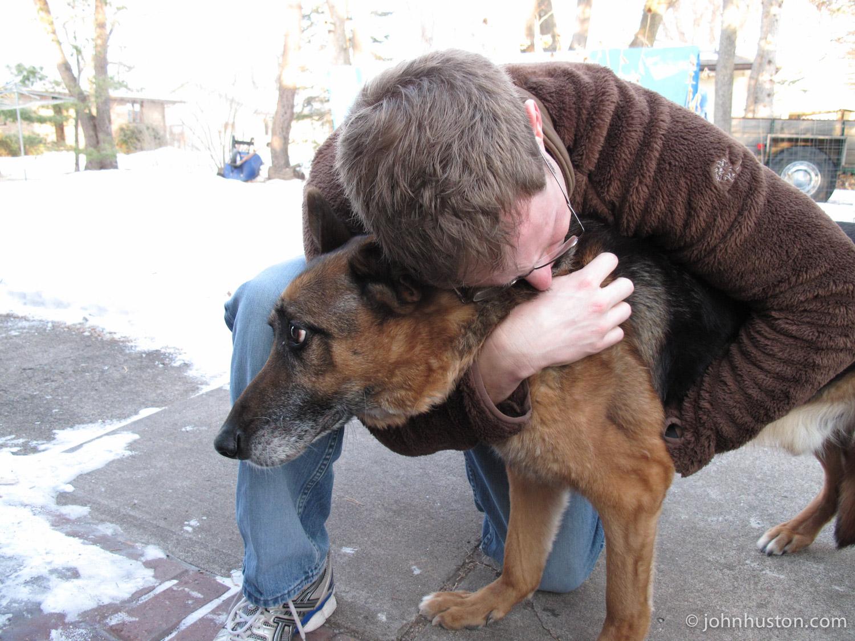 Tyler saying goodbye to his German Shepard, Bud.