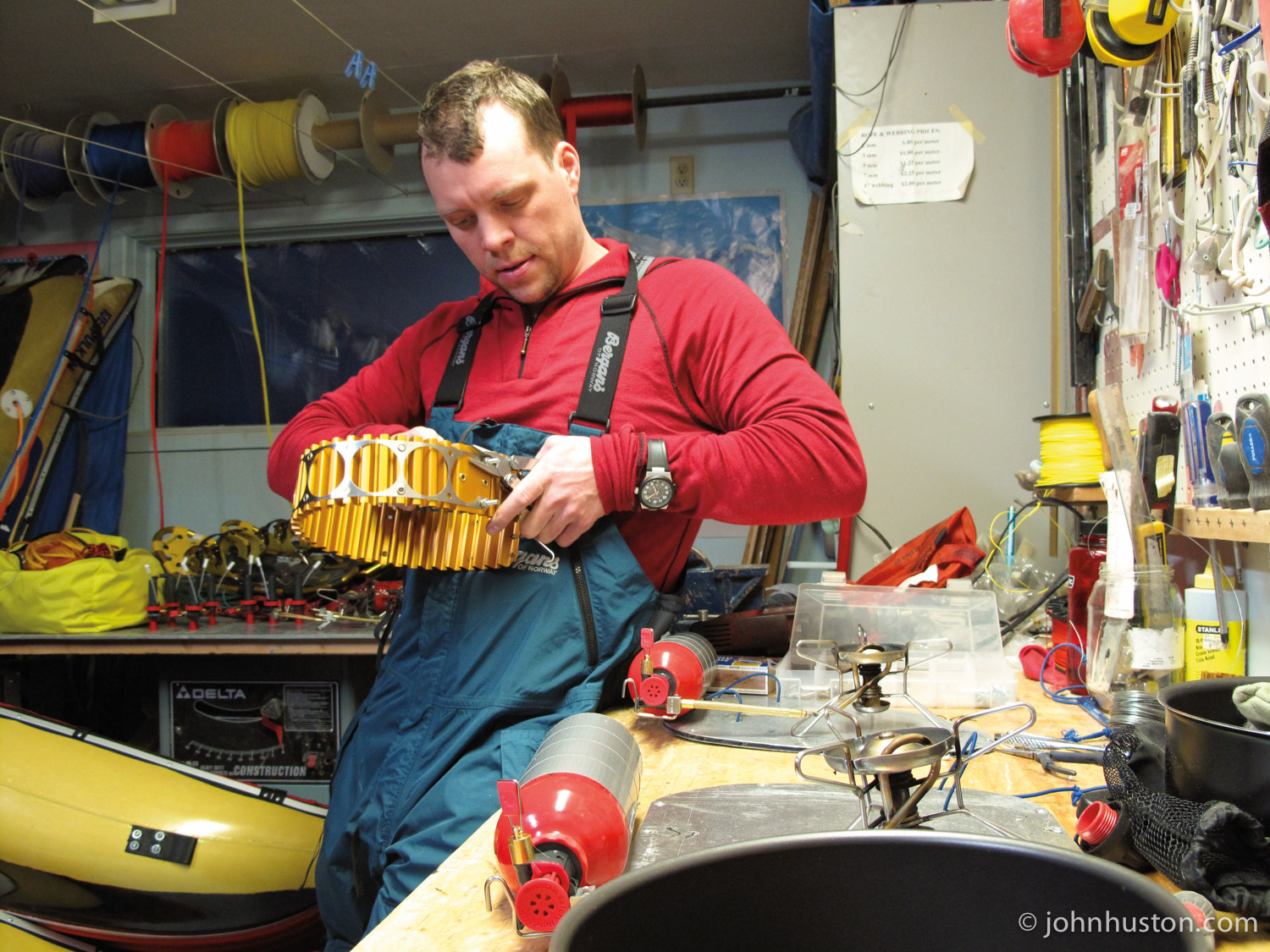 John, in Matty's workshop, putting together a heat exchanger, which increases stove efficiency.