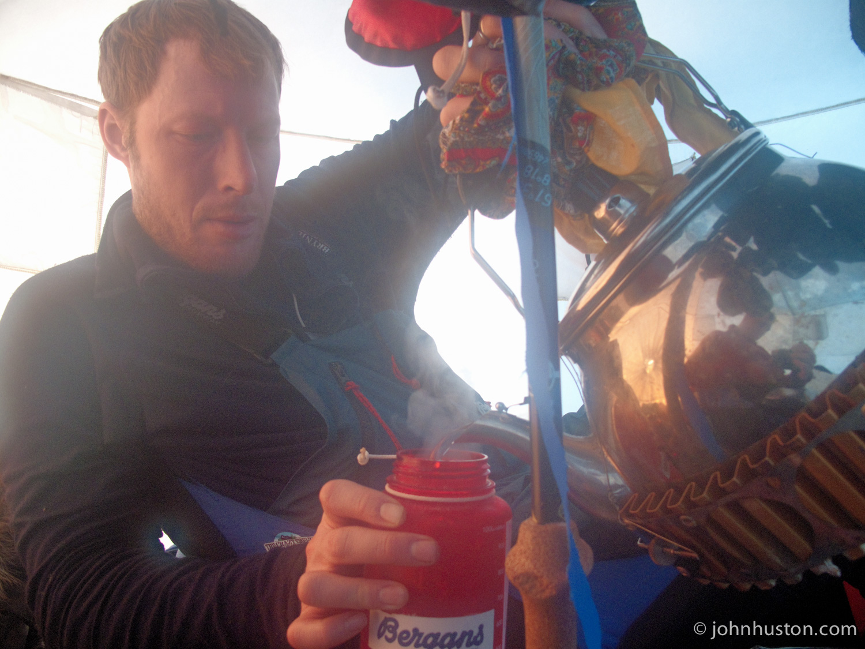 Tyler fills a water bottle.  We love our 7L tea pot.