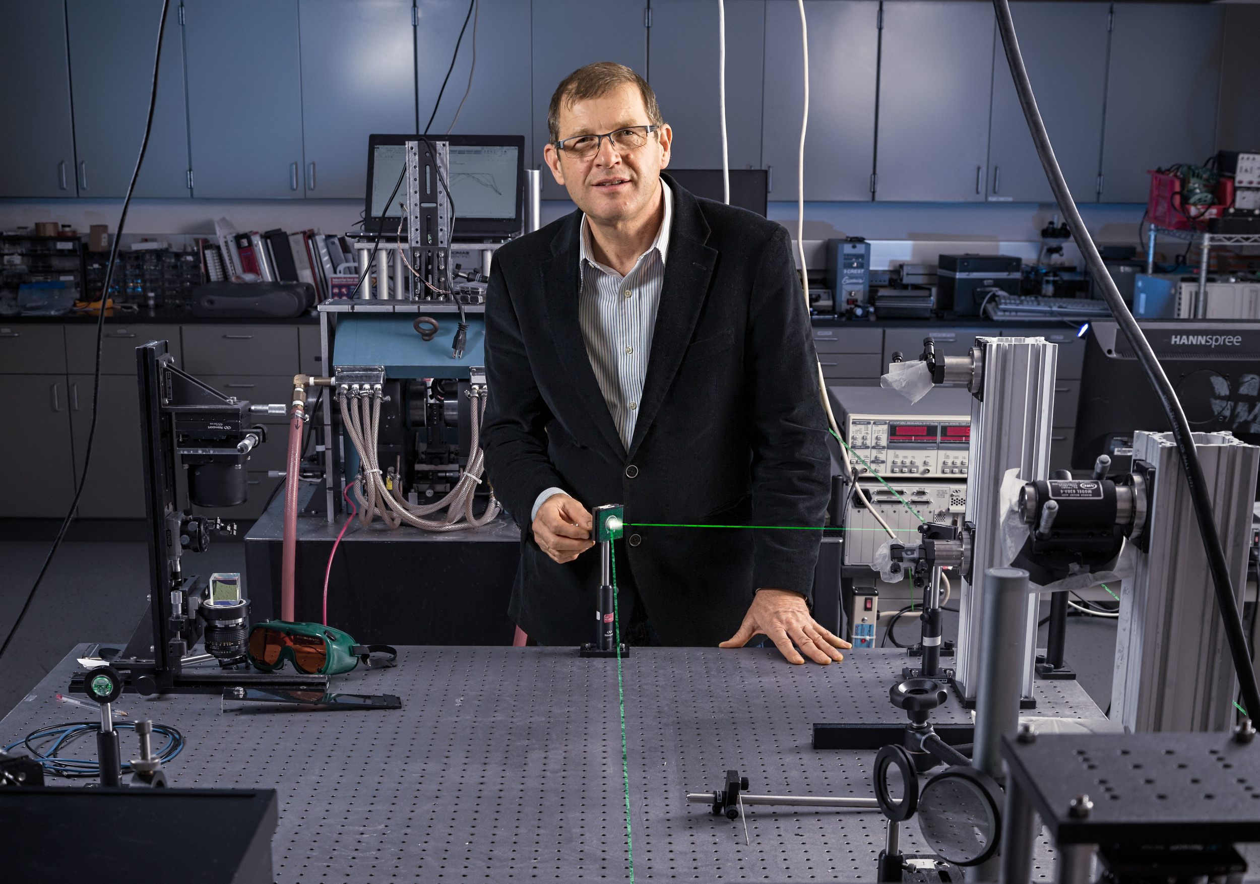 Dr. C. Zbigniew, Professor of Physics, University of Colorado at Colorado Springs In the UCCS laser lab. Photo by R.W. Firth