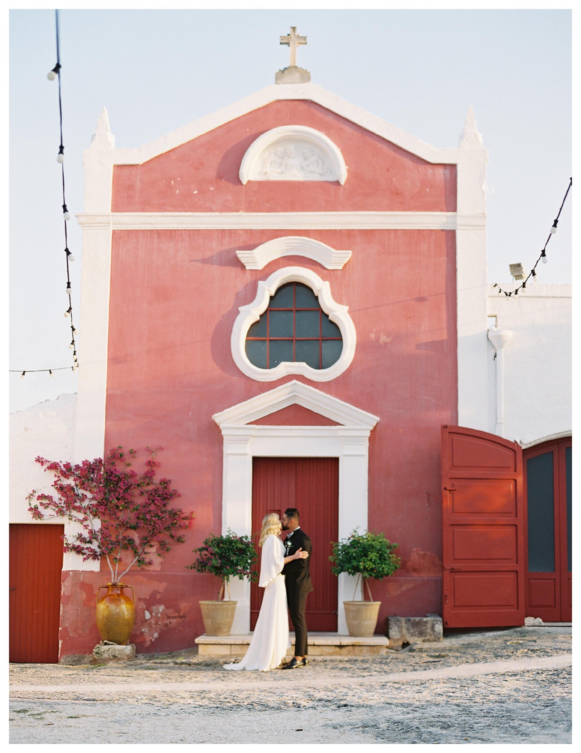 wedding kiss, wedding ceremony, masseria torre coccaro wedding, italy wedding, puglia wedding venue, alexandra grecco wedding dress, bride and groom