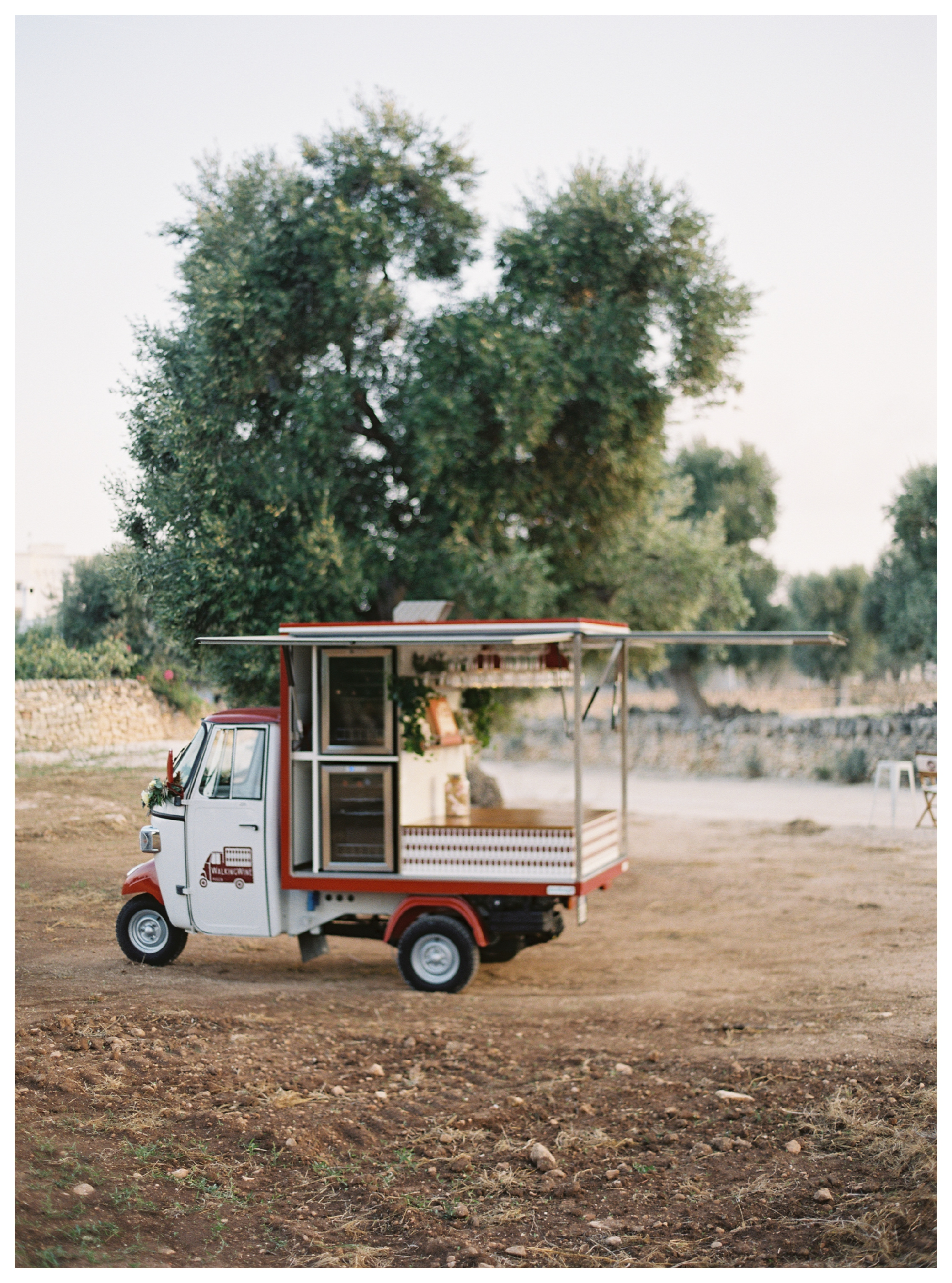 walking wine ape car, cocktail hour ideas, puglia wedding, destination wedding italy