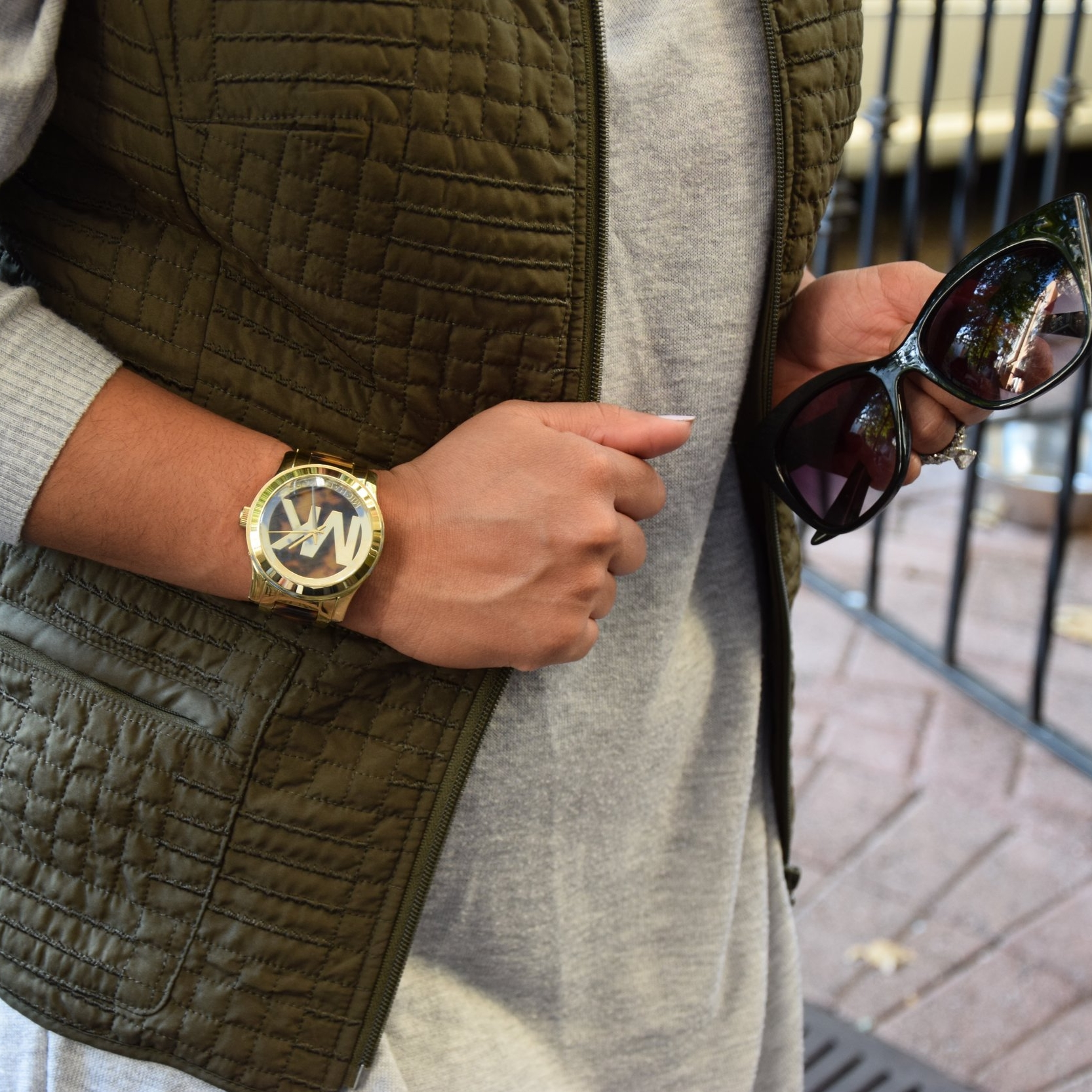 I love gold, so I added a gold and animal print MK watch as an accent to the army green vest and my bare forearms.