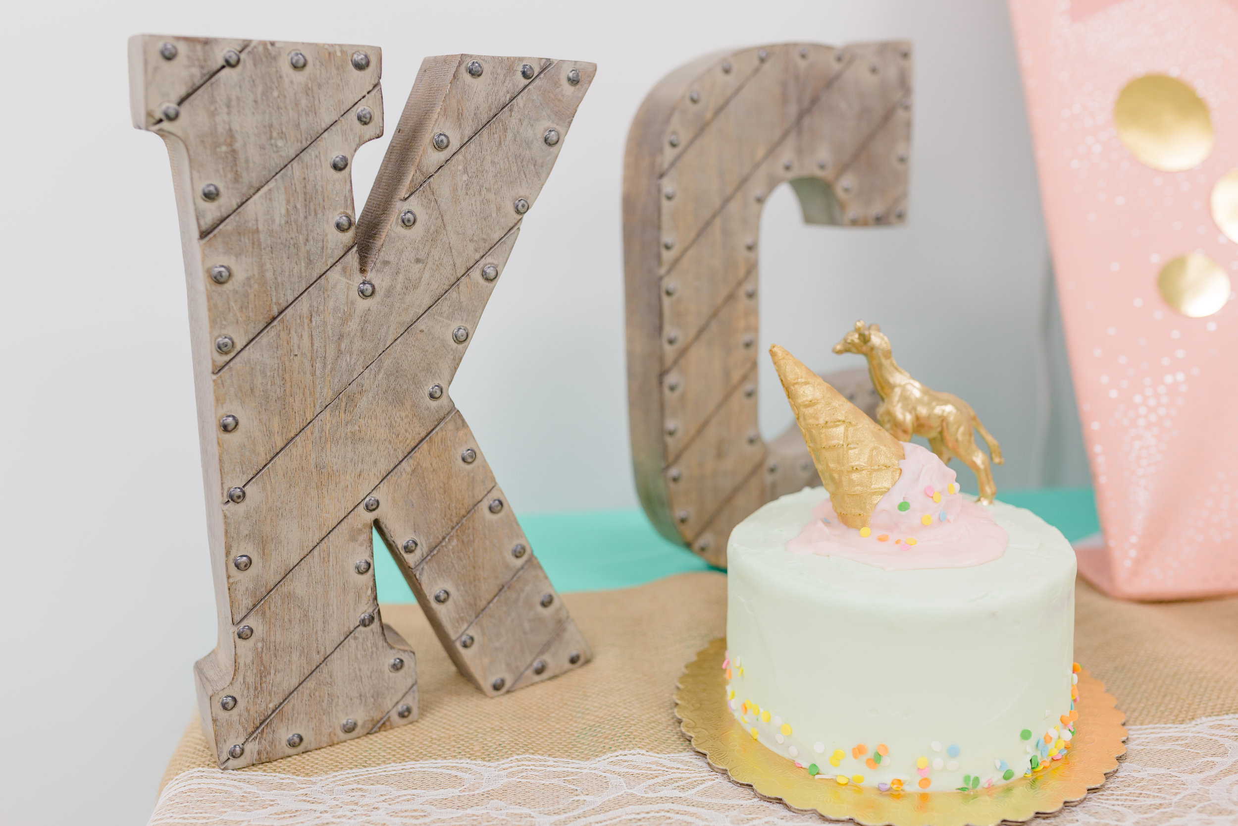 The mini smash cake Ariana made was the cutest up against Kalea's initials. The KC were a lucky find at Marshalls. The rustic color was perfect to help calm the bright tones of the table setting.