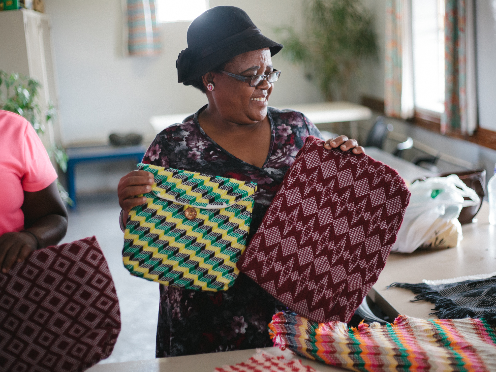Women at Boitekong in Bloemfontein create beautiful purses out of thread and used plastic bags. They sell the bags to raise money for the center.