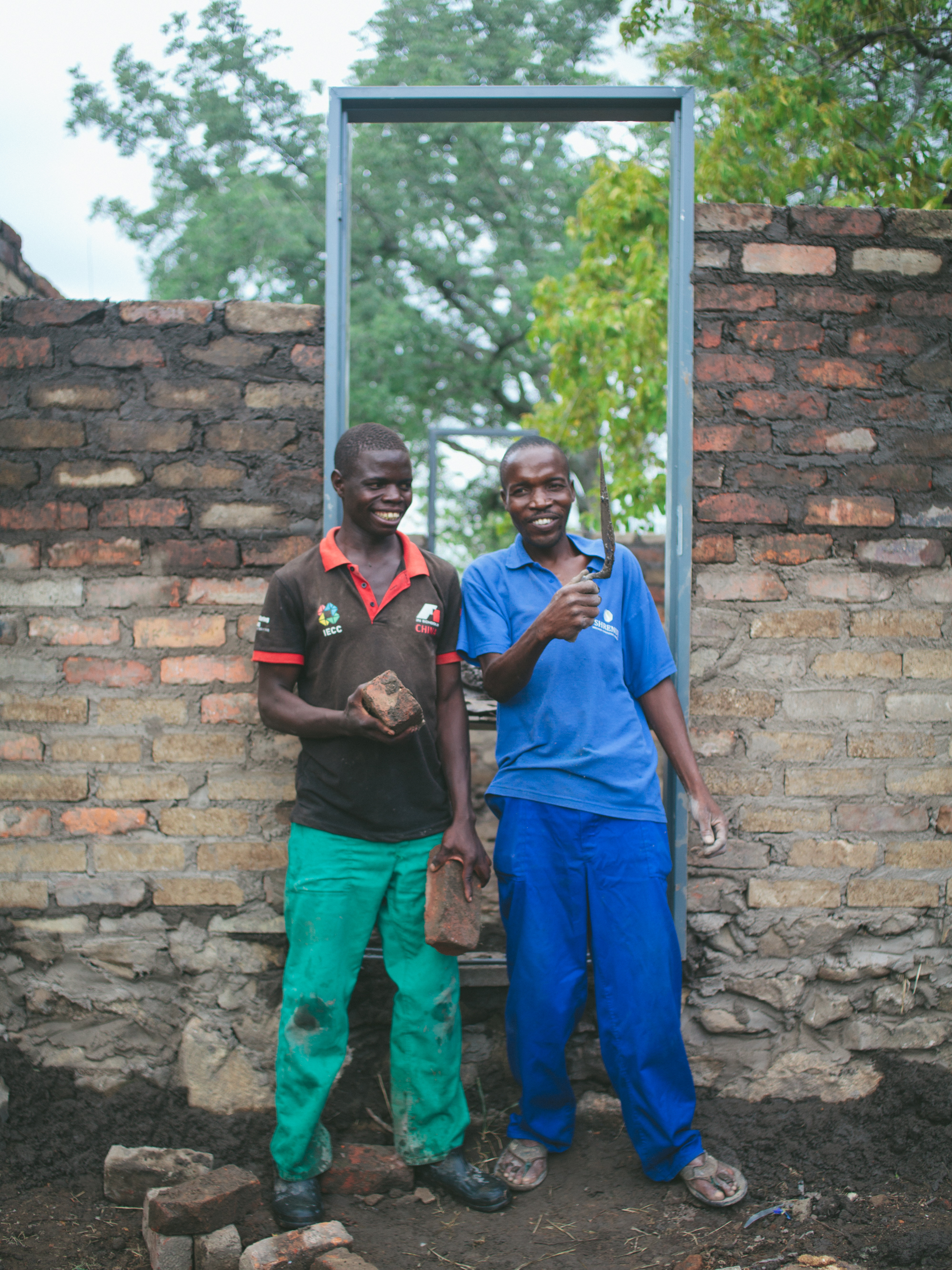 Two VMF workers construct new chalets for volunteers and visitors