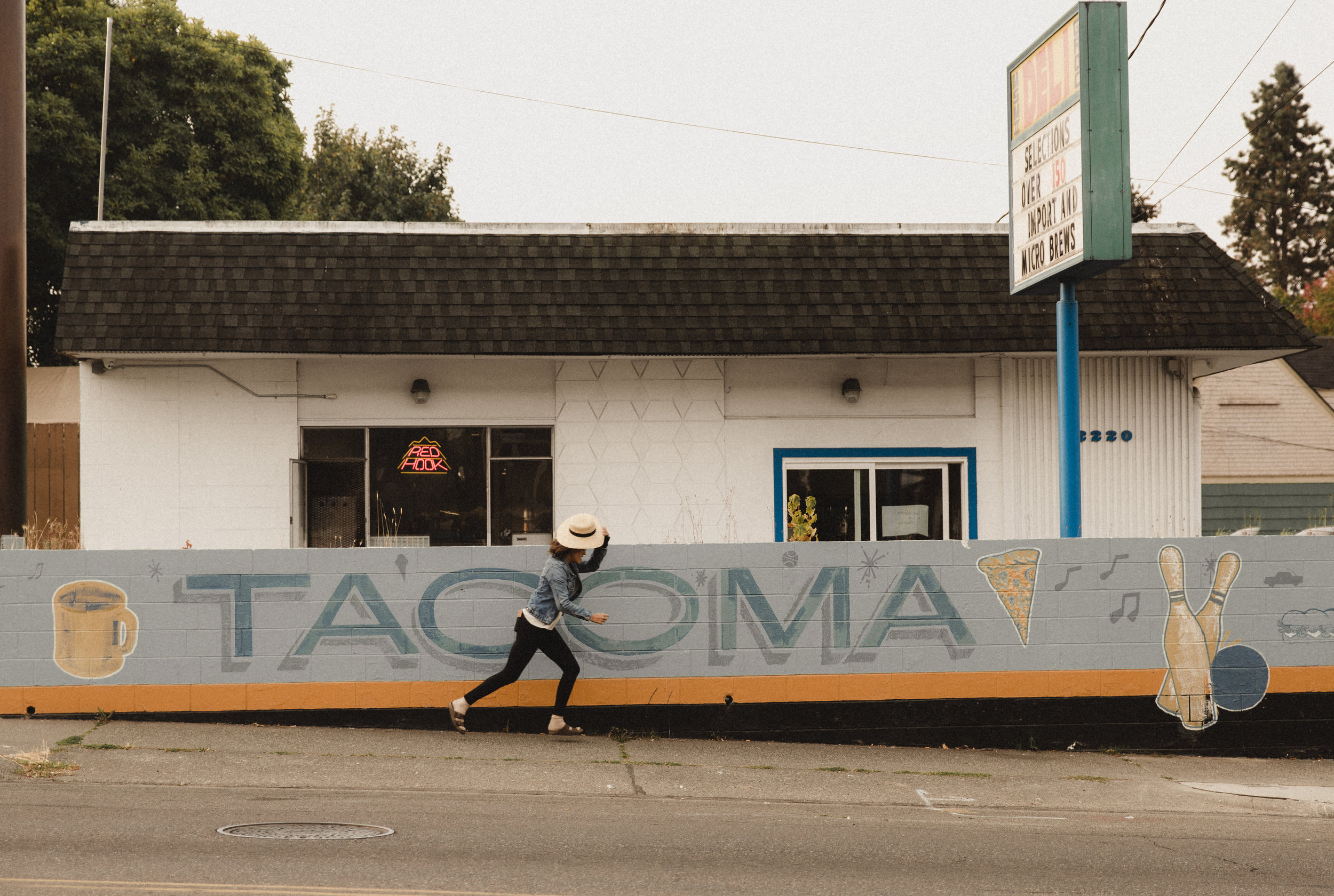 please enjoy this photo of me chasing my hat (per usual) in front of a little tacoma sign!