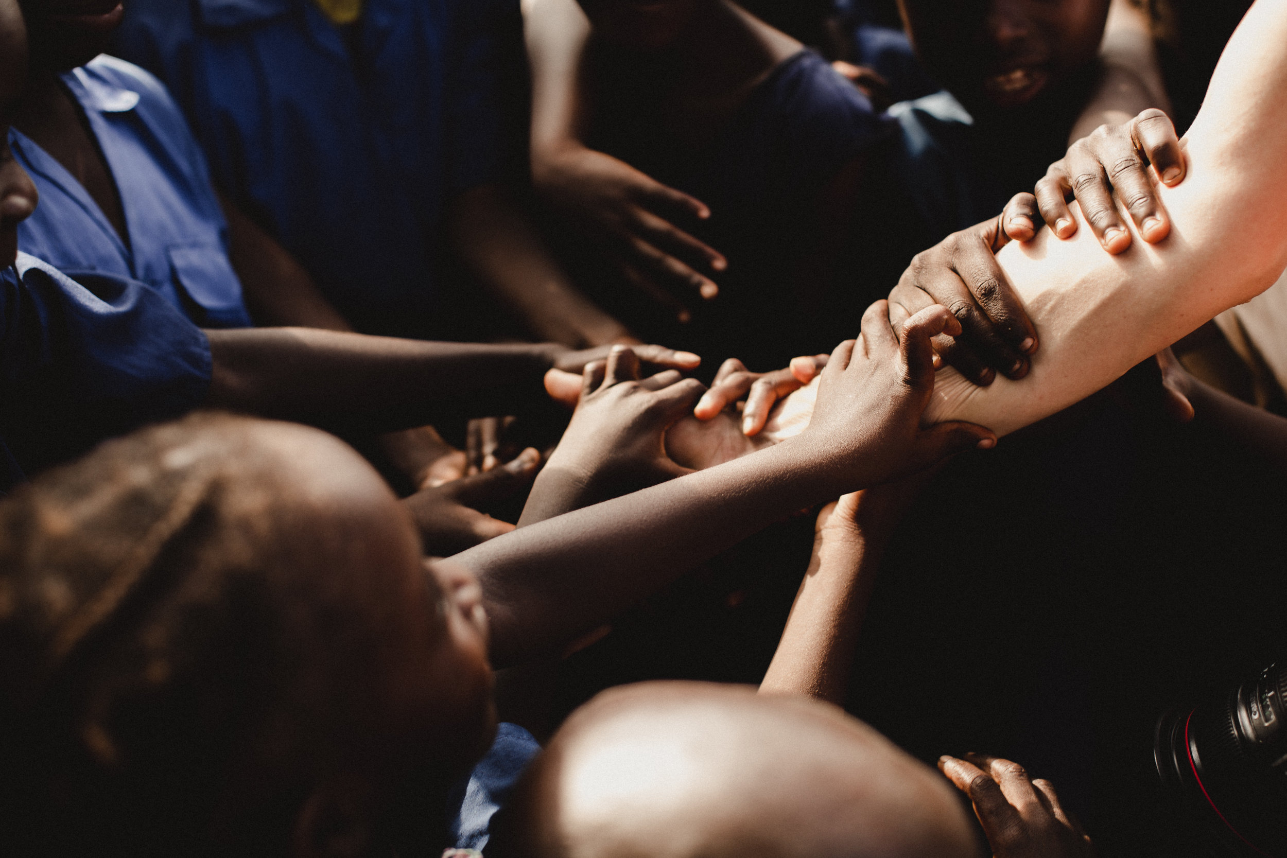this is one of my favorite moments captured on the trip. there is something so precious about a child experiencing a different culture for the first time. much like many of us had never seen africa, many of the children there have never seen another race. every day we would encounter countless children touching our skin with pure curiosity. this photo resembles just that, and provides a sense of unity for me. in knowing that through the many differences, we are all one.
