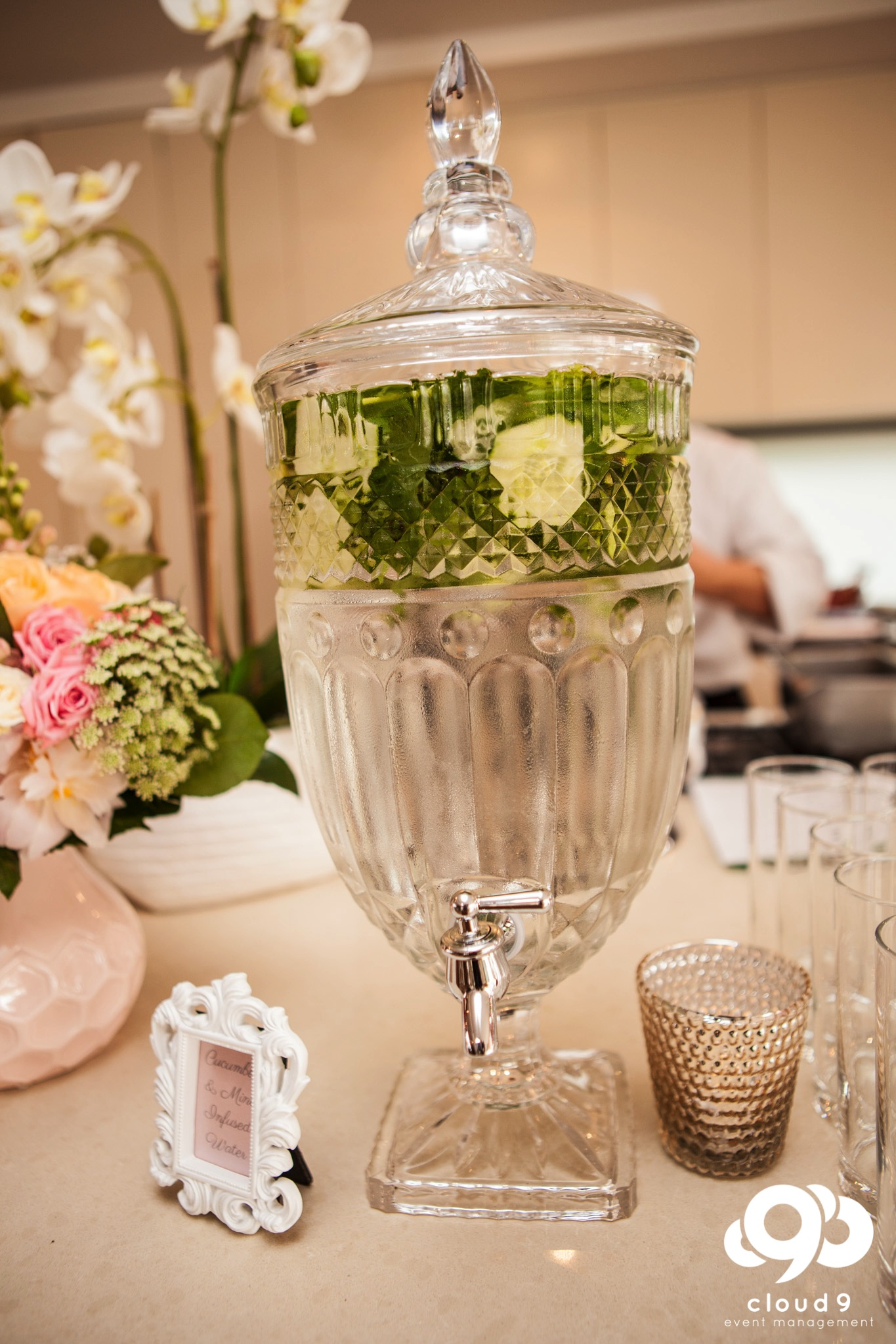 Fresh mint and cucumber infused water in crystal cut beverage dispenser
