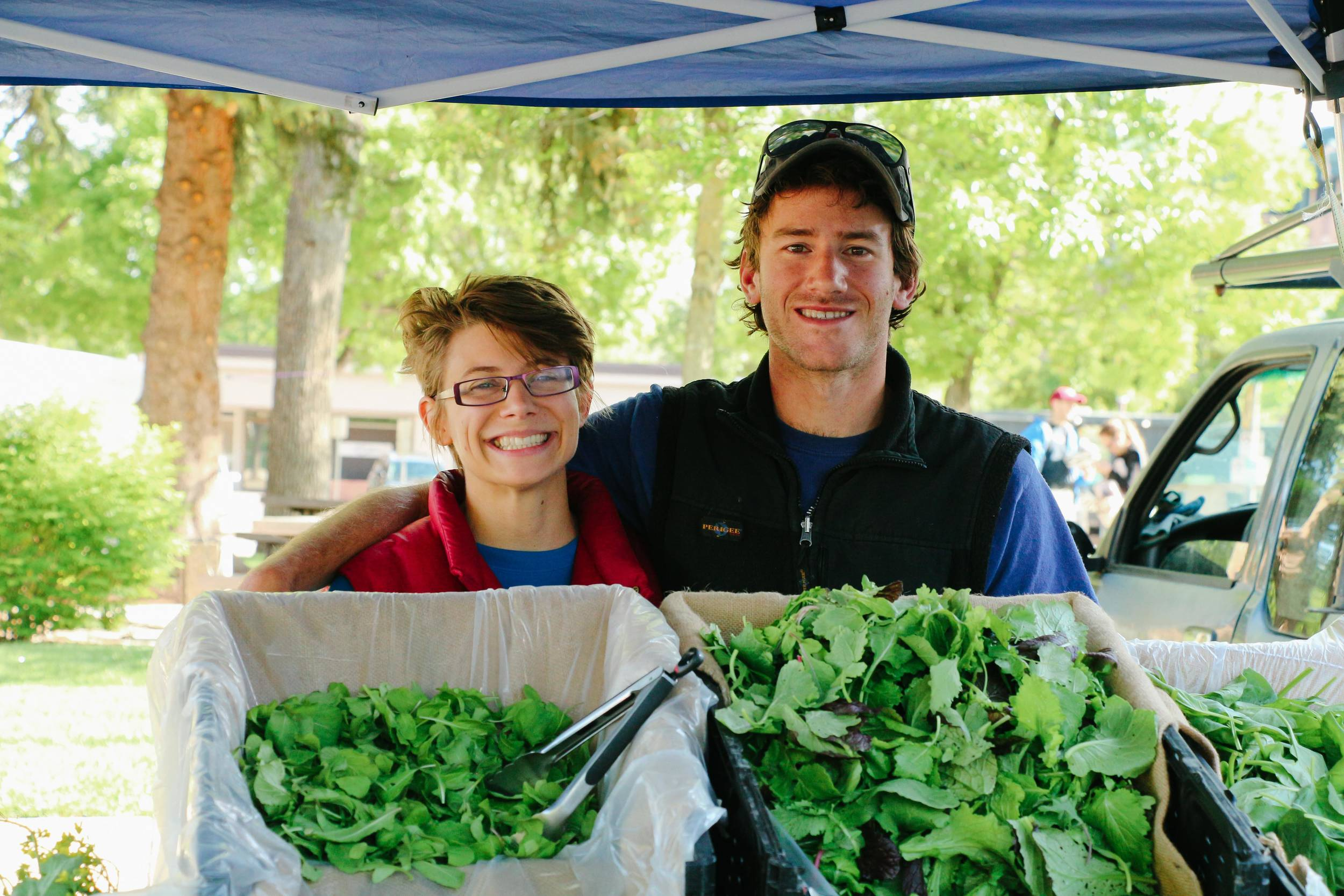 Ben and Natalie from Raisin Roots Farm at the Larimer County Farmer's Market